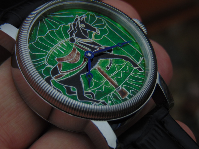 "Carousels horse"" enamel cloisonne dial watch. Tarcza z emali cloisonne. Srebro 999, średnica 36 mm. Wykonał Leszek Kralka."