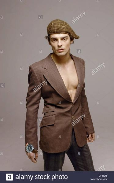 young-man-wearing-suit-jacket-and-no-shirt-DF36JN.jpg